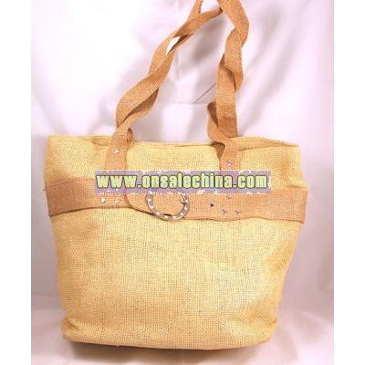 Brown straw knit beach handbag with buckle design