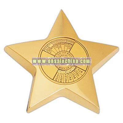 Brass star paper weight with calendar