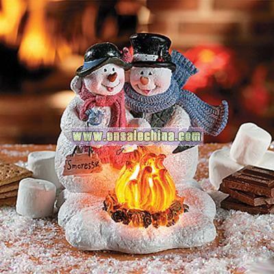 Snow Couple Roasting Marshmallows