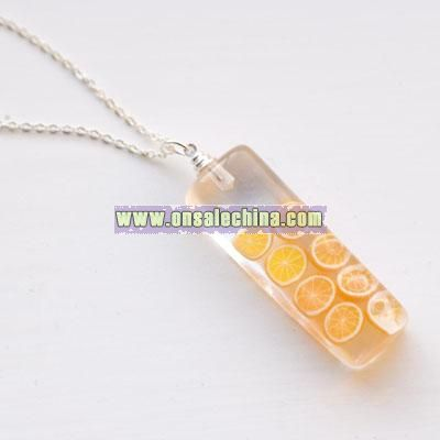 Orange Oranges resin pendant on 16 inch chain