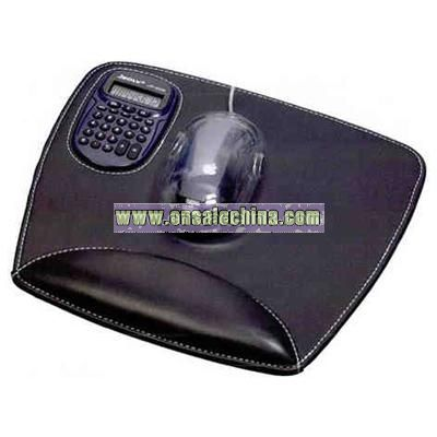 Mouse pad features removable calculator