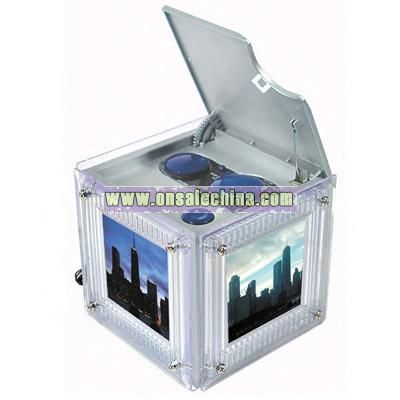 Photo cube AM/FM radio that features a three-sided photo frame