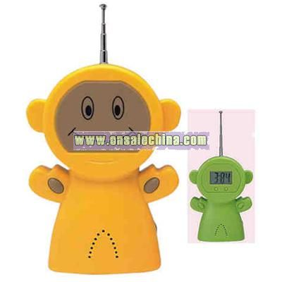 Auto scan FM radio with clock in shape of alien with smiling face