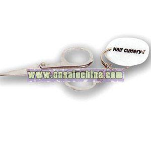 Silver folding scissors