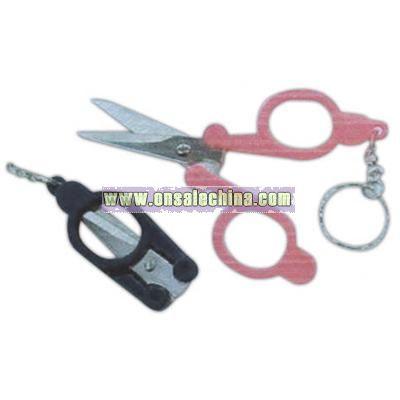 Pocket size key chain with folding scissors