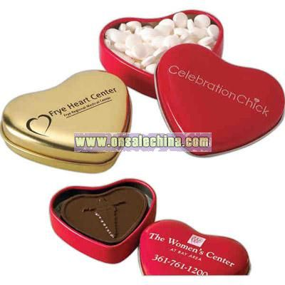 Heart shape tin filled with molded chocolate