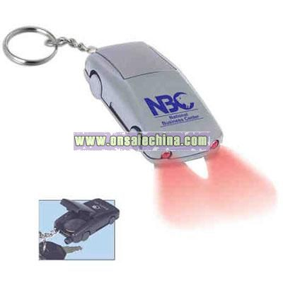 Car shape key holder/light with tailpipe whistle