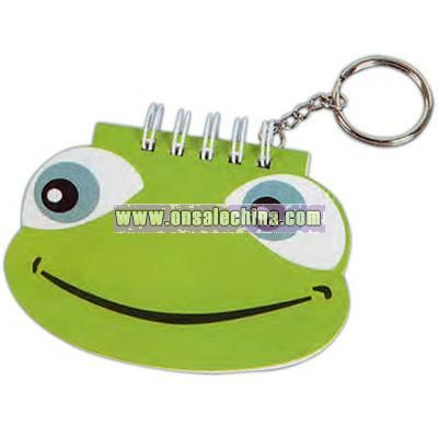 Key chain with frog shaped notepad.